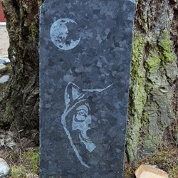 etched granite garden art of moon and wolf
